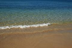 Small beach wave Stock Photos