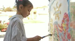 Little girl painting 4 Stock Footage
