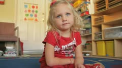 Little girl sitting Stock Footage