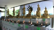 Flames Burn In Front Of Buddha Statues Stock Footage