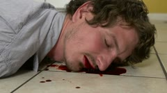 Man with bloody face on kitchen tile Stock Footage