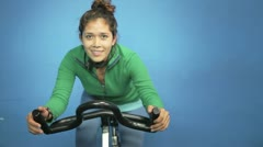 Girl on spinning bicycle Stock Footage