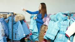 Family Shopping For Winter Clothes in Clothing Store Stock Footage