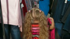 Little Girl Shopping Clothes Stock Footage