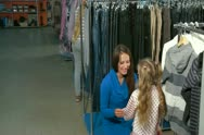 Mother and Daughters Clothes Shopping Stock Footage