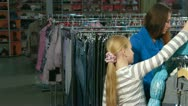 Family Shopping For Clothes in Clothing Store Stock Footage