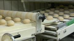 10736 roll bun on conveyor belt dolly wide quick Stock Footage