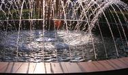 Fountain, lit setting sun. Stock Photos