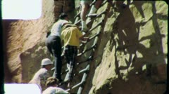 Tourists on Ladder MESA VERDE National Park 1960s Vintage Film Home Movie 4876 - stock footage