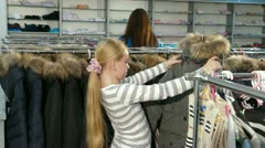 Shopping For Winter Clothes in Clothing Store Stock Footage