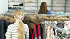Family Shopping For Girls Clothes in Clothing Store Stock Footage