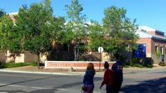 Students Walk By Northern Arizona University Sign Stock Footage
