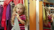 Family Shopping For Girls Clothing Stock Footage