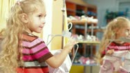 Shopping For Childrens Clothes In Clothing Store Stock Footage