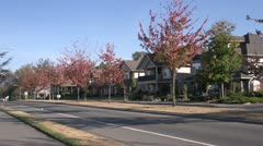 Suburban homes and street, lower mainland, autumn Stock Footage