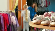 Family Shopping for Children's Clothes Stock Footage