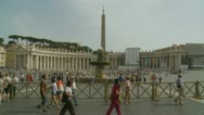 Two men admire St Peter's Square in the summer Stock Footage