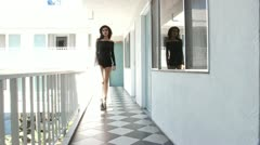 Sexy fashion female woman walking towards camera and closing door - stock footage