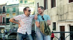 Two men standing on the bridge in Venice, steadycam shot Stock Footage