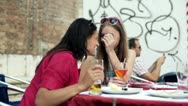 Two women sitting in the restaurant and chatting, steadycam shot Stock Footage