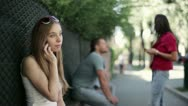 Beautiful young woman talking on mobile phone on the street Stock Footage