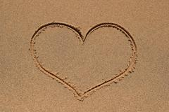 Heart drawing in sand Stock Photos
