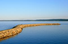Breakwater at sunset, lake St-Jean - stock photo