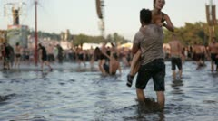 Couple cheer in mud at open-air concert Stock Footage