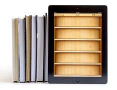 ipad 3 with books application on books - stock photo