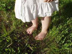 feet in grass - stock photo