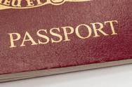 Stock Photo of British passport word close up shallow focus.