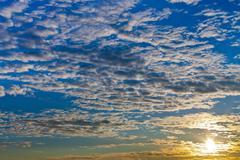 Clouds blue sky at autumn sunrise Stock Photos