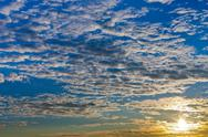 Stock Photo of clouds blue sky at autumn sunrise