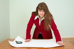 Business woman was inclined over the plan Stock Photos