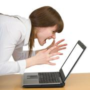 Girl emotionally shouts at the laptop Stock Photos