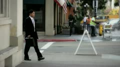 Businessman Walks 2 Stock Footage