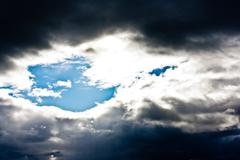 Light Piercing Through Clouds - stock photo