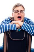tired traveller woman yawning - stock photo