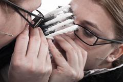 Drug addicted businesswoman snorting cocaine Stock Photos
