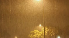 Heavy monsoon downpour rain at night near street light with sound. Stock Footage