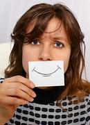 tired woman smiles as may - stock photo