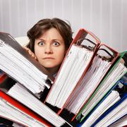 accountant swamped with financial documents - stock photo