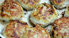 Fried cutlets on a frying pan Stock Footage