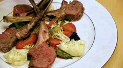 Lamb Chop Dish with Strawberries and Leafy Greens - stock footage