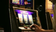 Playing Slots 2 Stock Footage