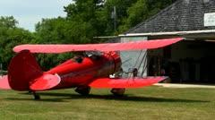 Red biplane engine warmup Stock Footage