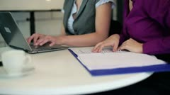 Businesswomen hands typing on notebook computer in the office Stock Footage