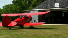 Red biplane taxi's Stock Footage