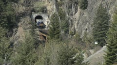 Rocky Mountaineer Tunnel Fraser River MS short bridge Stock Footage