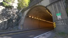 Transport trucks entering tunnel wide shot Stock Footage